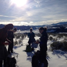 The winter study crew checking GPS cluster locations to find wolf kill sites and track wolf pack movement.